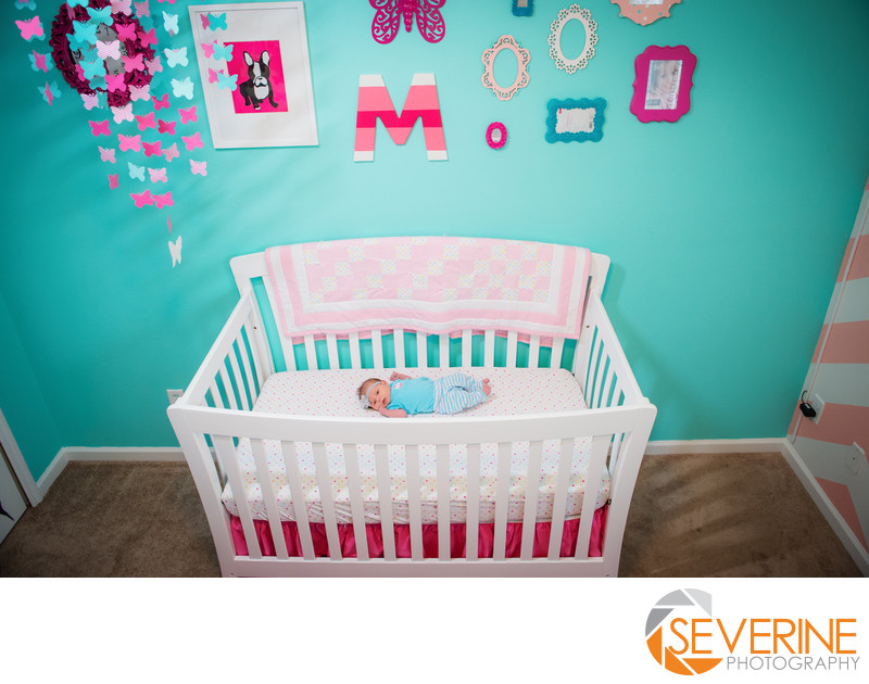 newborn girl in nursery pink and blue butterfly
