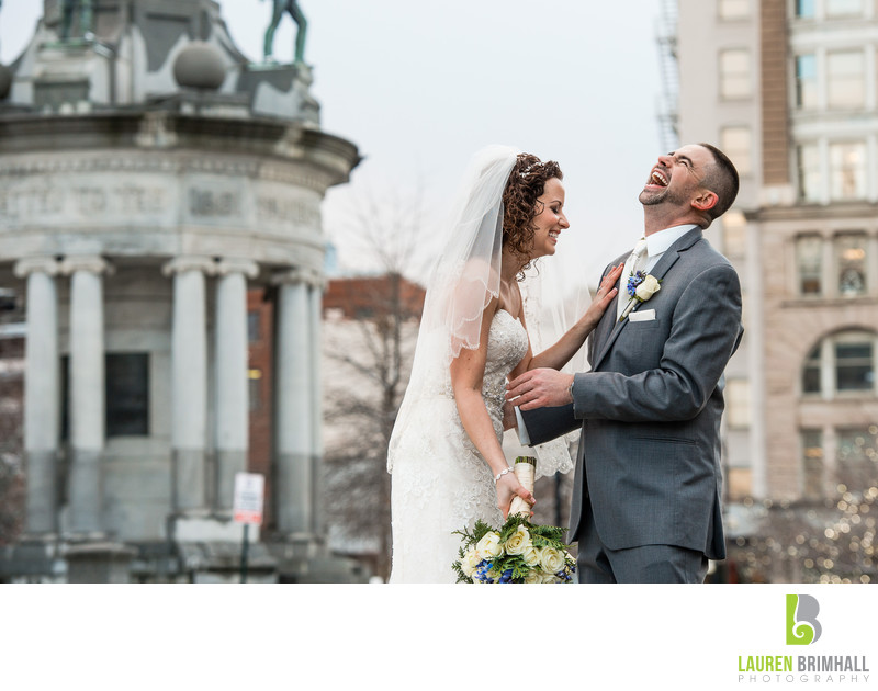 Bride and groom laughing portrait