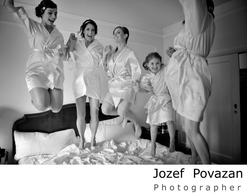 Fairmont hotel bride with flower girl jumping on bed