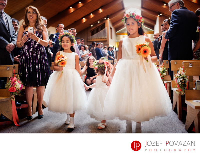 Flower girls walking in the isle at Hart House wedding