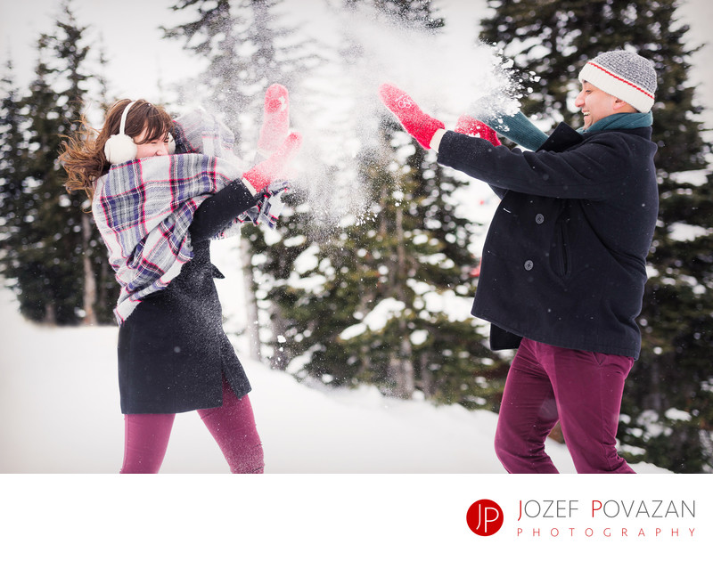 Whistler engagement photography winter fun snow fight