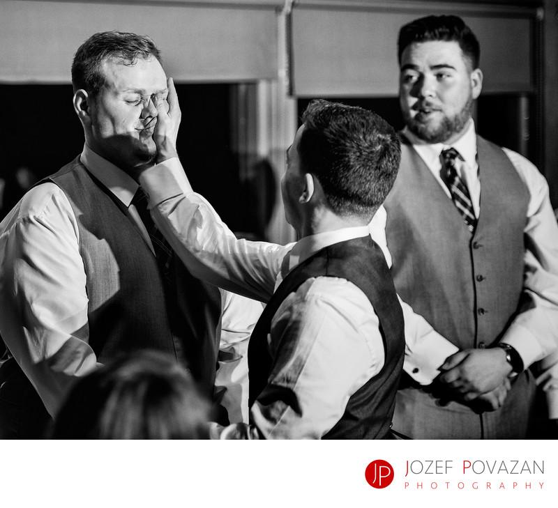 Furry Creek wedding photography groom slapping best man