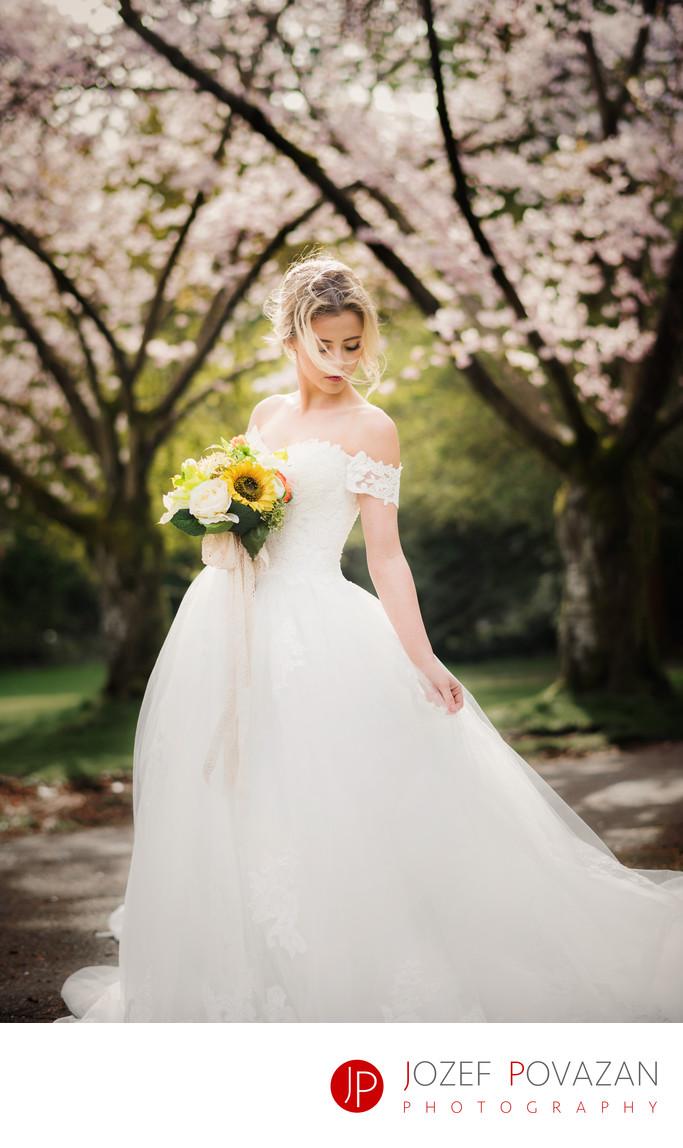 Cherry blossoms wedding bride portrait in white gown