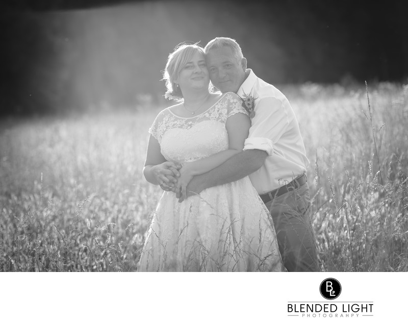 Backlit sunset raleigh wedding couple portrait