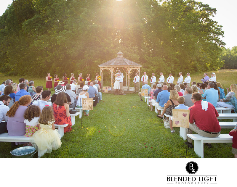 Sunny backlit outdoor wedding kiss raleigh photography