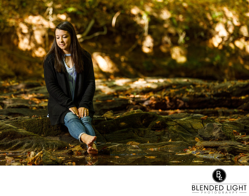 High School Senior enjoying the creek in fall