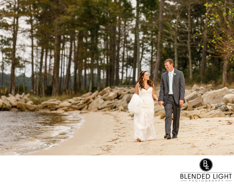 Hand-in-Hand wedding day beach walk