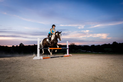 Young teen working on her equestrian jumping technique