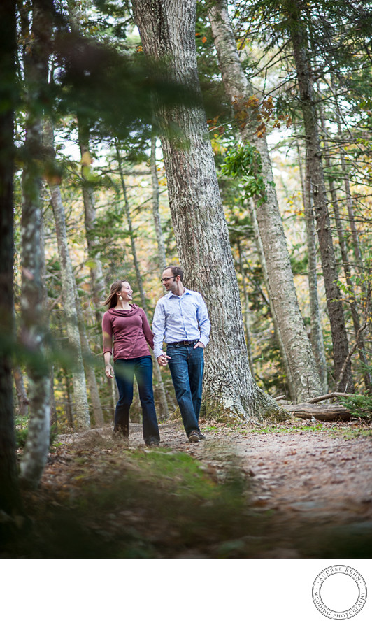 Wedding couple walking in the Maine woods