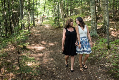 Lovely lesbians walking in the woods