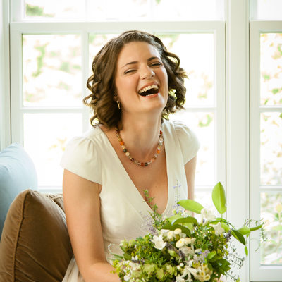Laughing Bride in a Window Seat