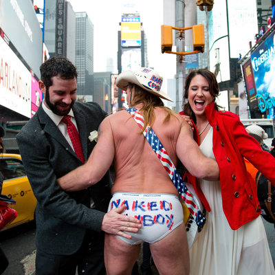 Bride and Groom and Naked Cowboy in Times Square