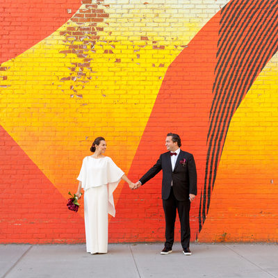 Bride and Groom by mural on York Street in DUMBO