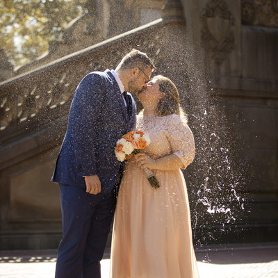Couple kissing at Bethesda Terrace after marrying