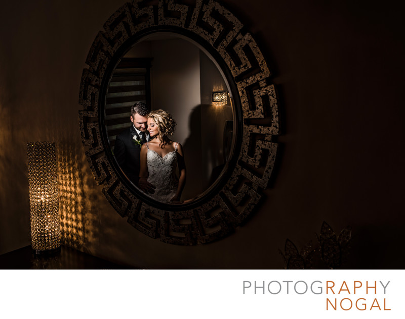 Couple Reflection in the Mirror on Wedding Day