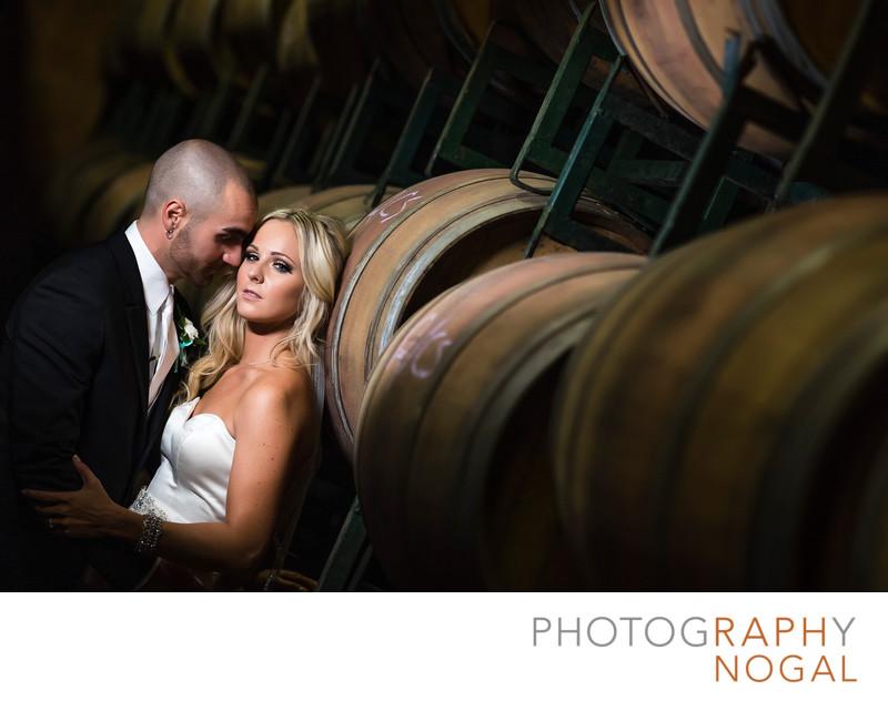 Bride and Groom in Barrel Room at Hernder Estate Wines