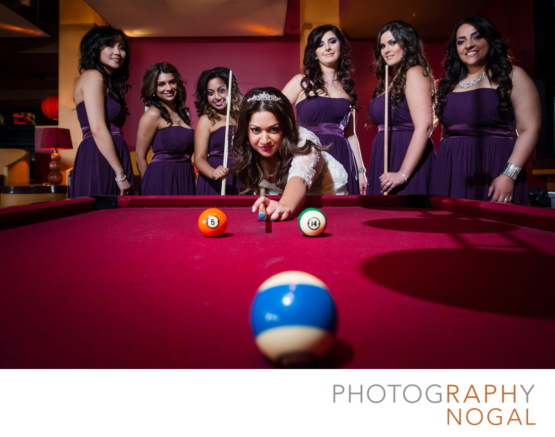 Bride and Bridesmaids Playing Pool