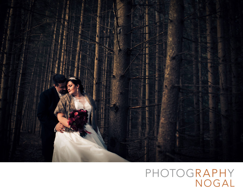 Bride and Groom in the Forest During Winter Wedding