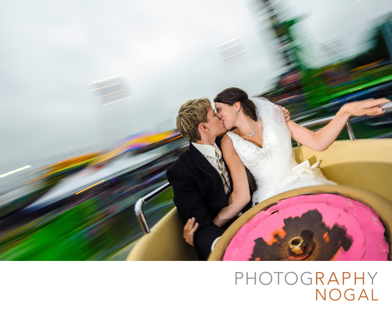 Bride and Groom Kiss at Orno Fair in Teacup Ride