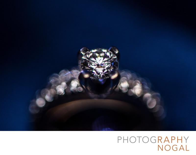 Diamond Ring Detail on Blue Background