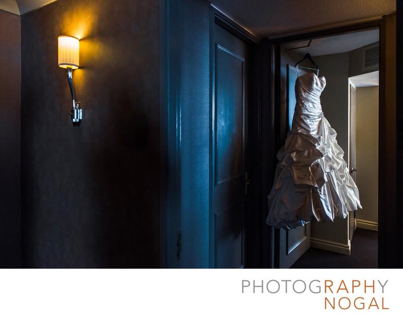 Wedding Dress Hanging At The Doorway