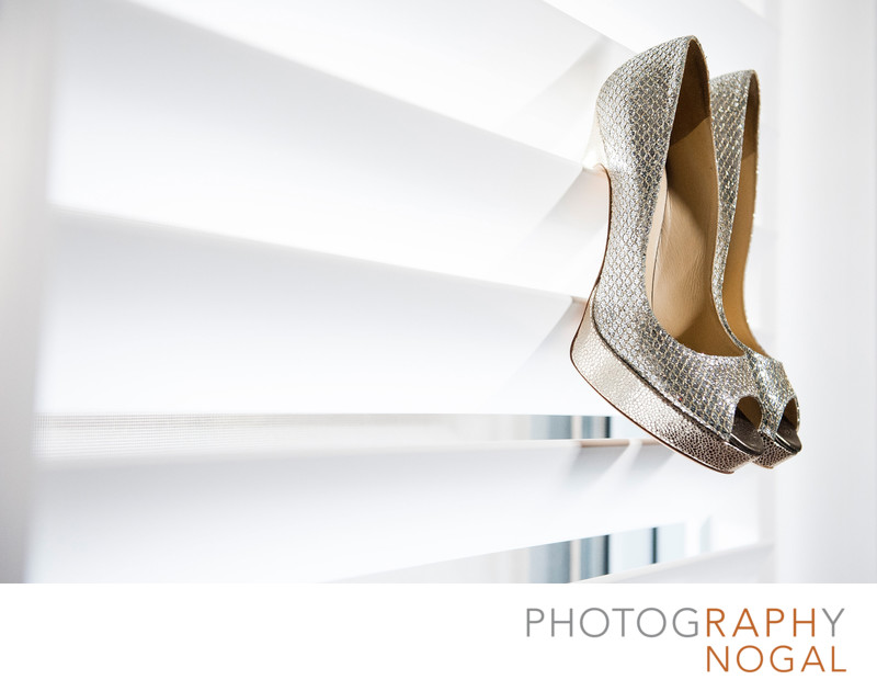 Wedding Shoes Hanging On Window Shades