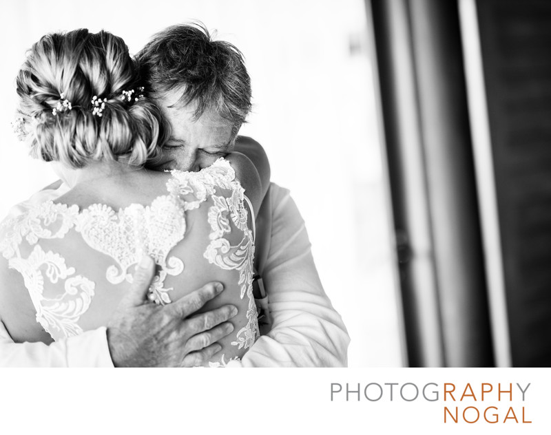 Bride and Father Embrace After First Look