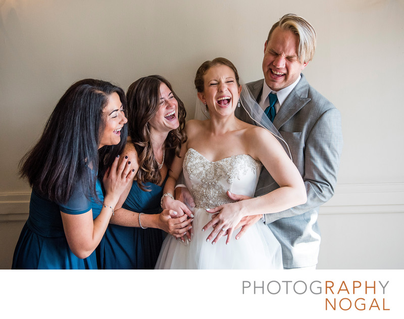 Bride and Wedding Party Laughter