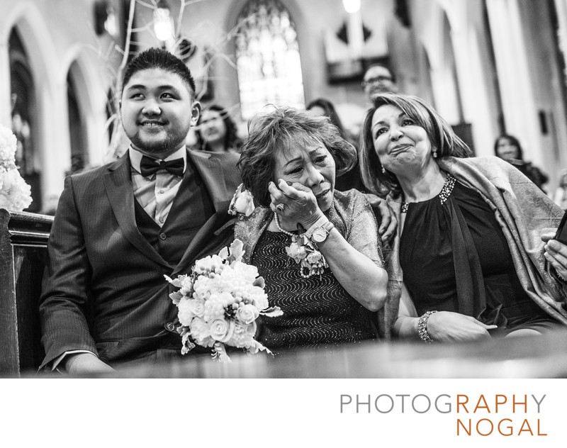 Bride's Mom Wiping Tears Away at Church