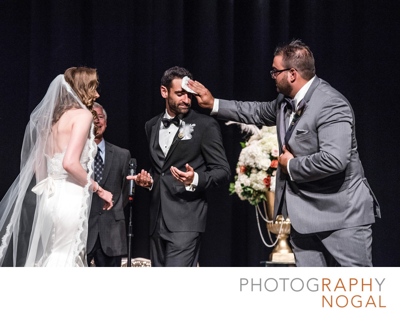 Wiping Sweat for Groom's Forehead