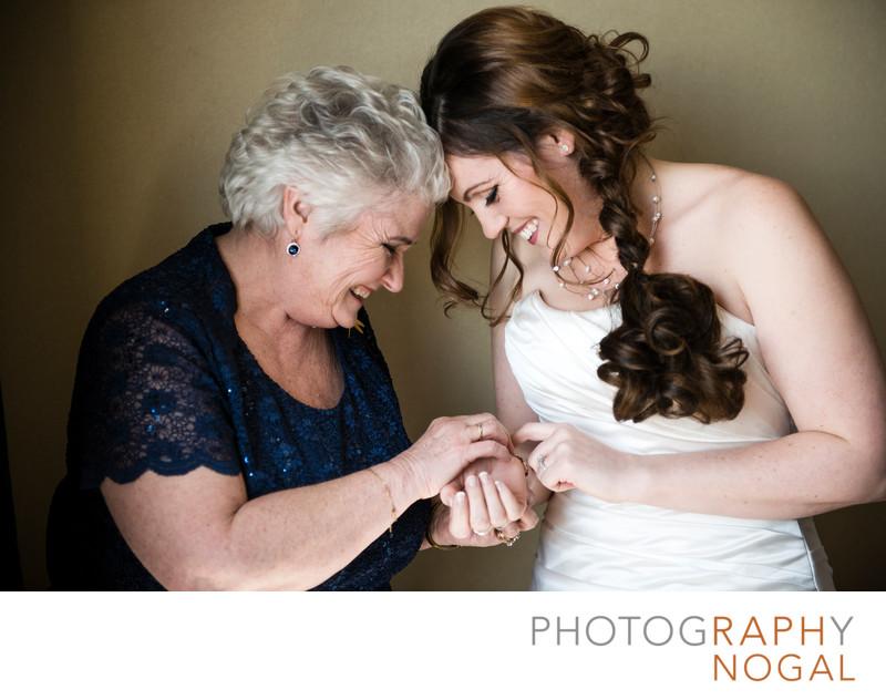 Bride and Mom Putting On Bracelet