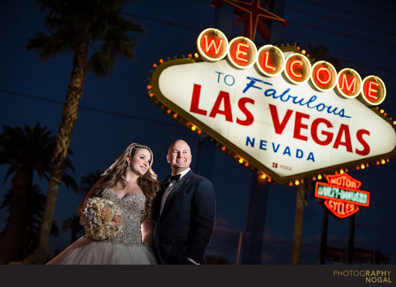 Bride and Groom in Front of Las Vegas Welcome Sign