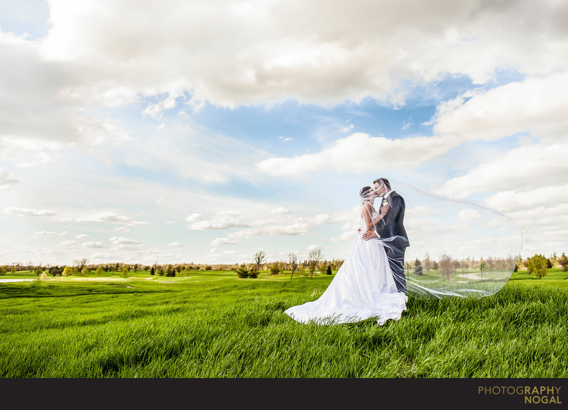 Bride and Groom Kiss at RattleSnake Point Golf Club