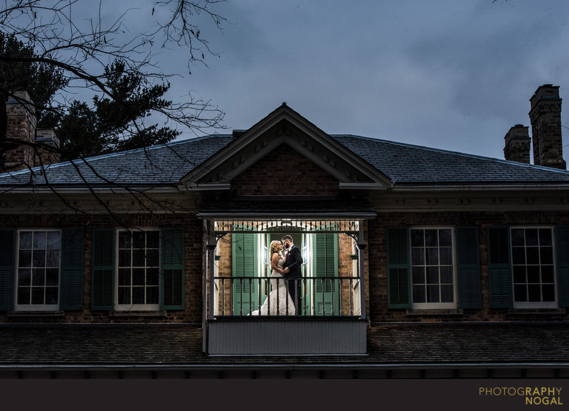 Bride and Groom on Balcony of Benares Historic House