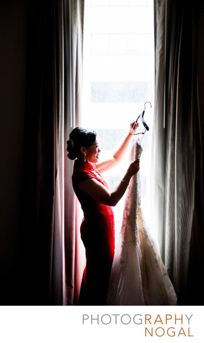 Bride Admiring Wedding Dress In The Window