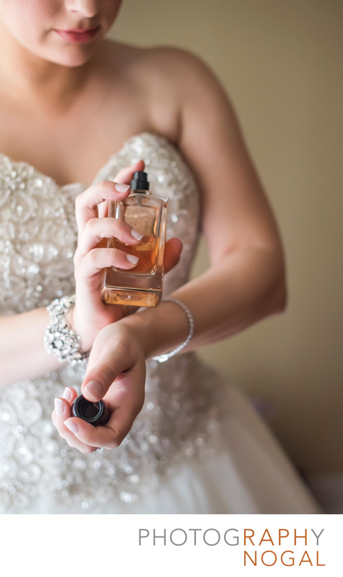 Bride Putting On Perfume Before Leaving For Church