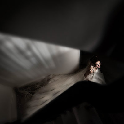 Bride Walking Down Stairs After Getting Ready