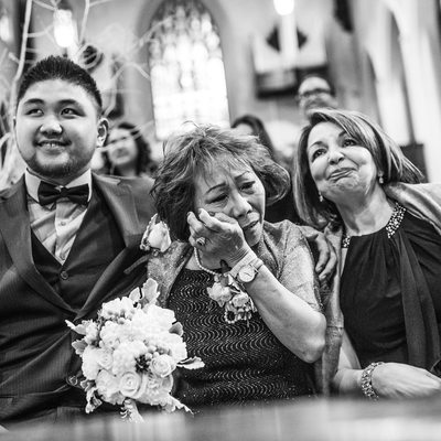 Bride's Mom Wiping Tears Away at Church