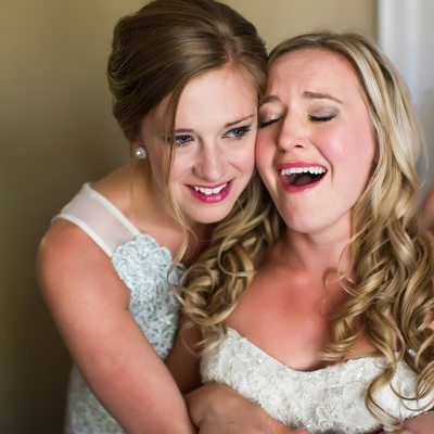 Bride Crying After Hugging With Bridesmaid