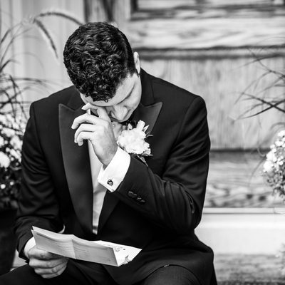 Groom Wiping Tears Away After Reading Letter From Bride