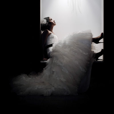 Bride with High Heels in Alcove of Novotel Hotel