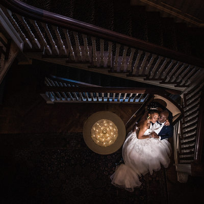Couple at Bottom of the Stairs at Graydon Hall Manor