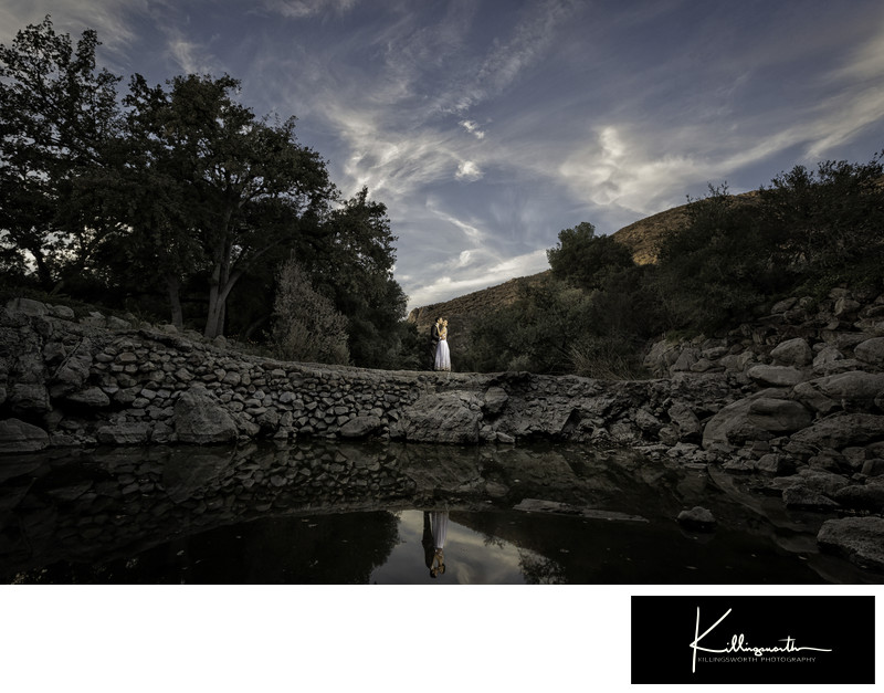 bride and groom wide reflection photo