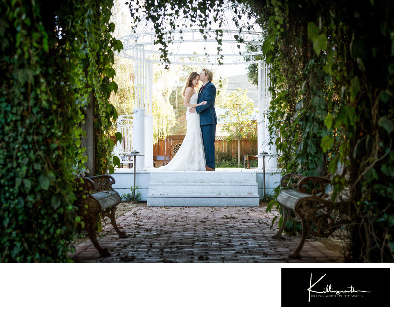 groom kissing his bride under 1880 union hotel ceremony gazebo