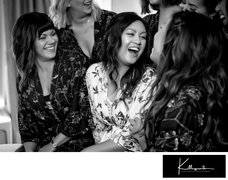 bridesmaids laughing in robes
