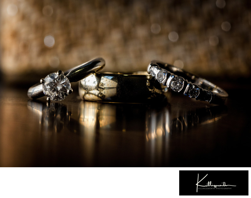 golden wedding rings with reflection