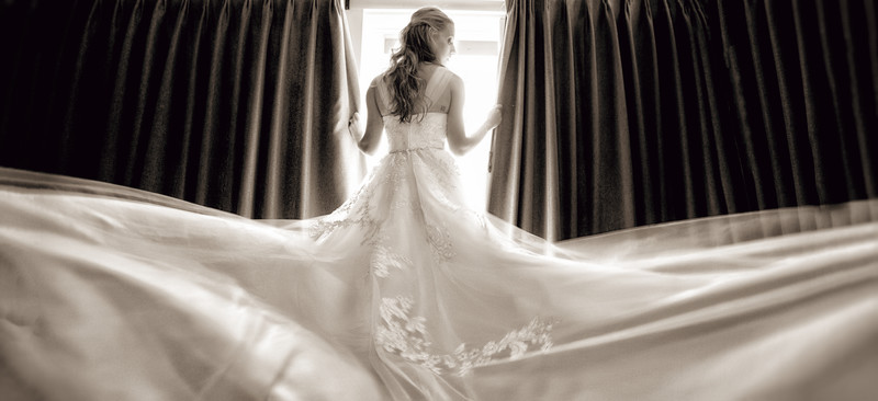bride looking out westlake village inn window