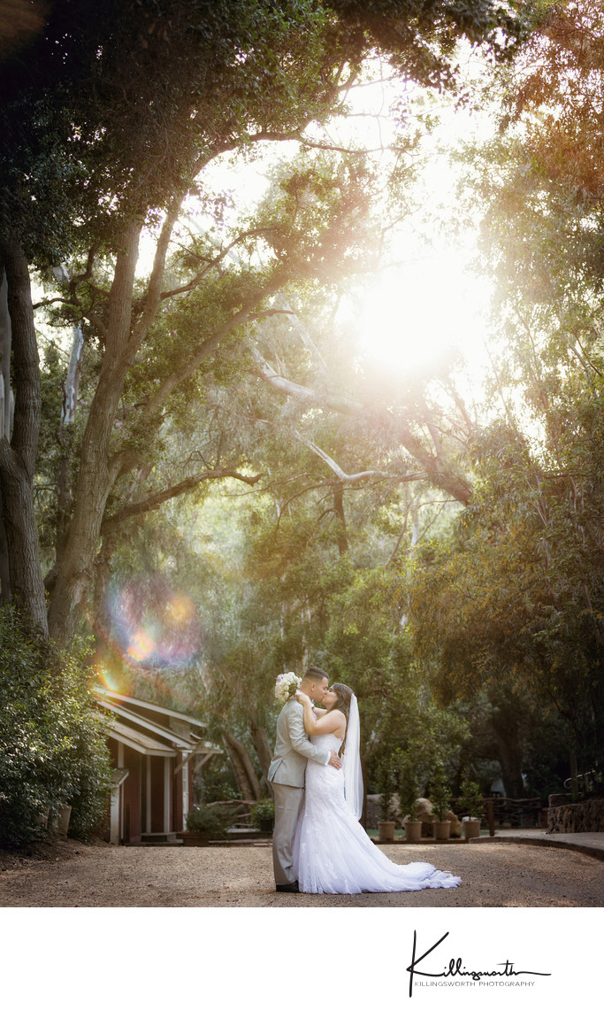 bride and groom kissing at Calamigos Ranch wedding venue
