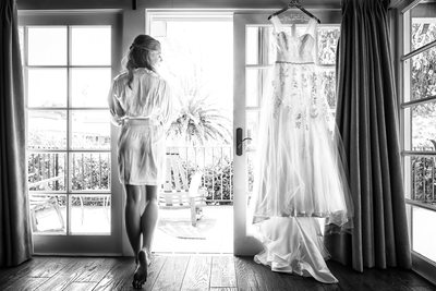 bride standing in doorway with wedding robe