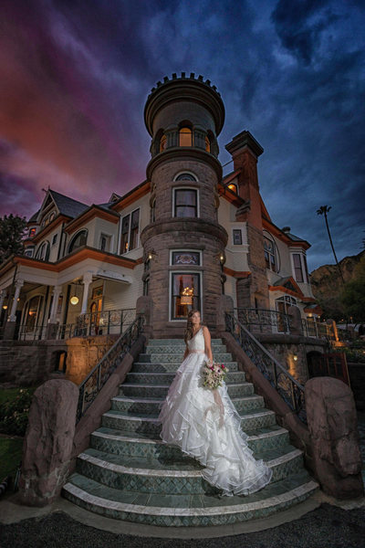 epic bride standing on the stairs of the Newhall Mansion